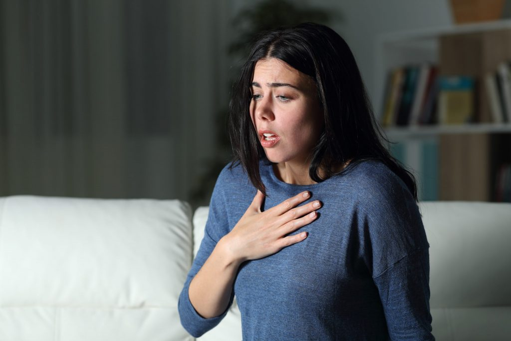 A woman suffering from trauma leading to the connection of her anxiety disorder.